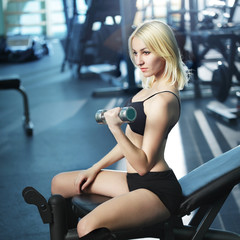 Young woman dumbbells training