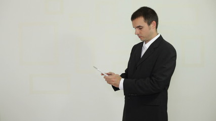 Businessman texting message on digital tablet