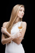 young blond woman holding glass of white wine