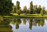 Reflections on golf course with golf clubs