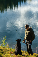 Fisherman and dog