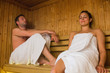 Happy couple relaxing in a sauna