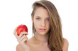 Attractive brunette model holding an apple