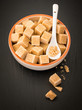 Brown sugar cubes in a ceramic dish
