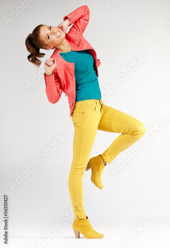 young brunette woman in autumn color isolated on grey background