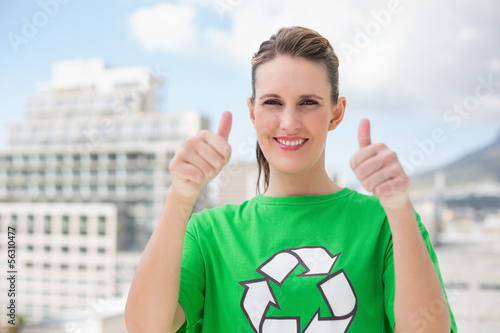 Smiling environmental activist giving thumbs up