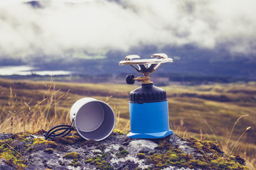 Gas camping stove and pot in the mountains