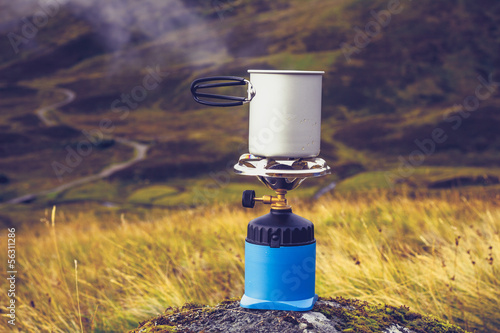 Gas stove with pot of boiling water in the mountains