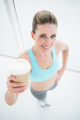 Fit smiling woman holding coffee