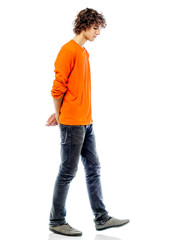 young man walking sad bore side view