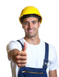Latin worker showing thumb up