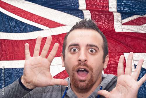 young amazed man portrait with british flag
