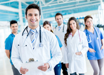 Male doctor with a medical group