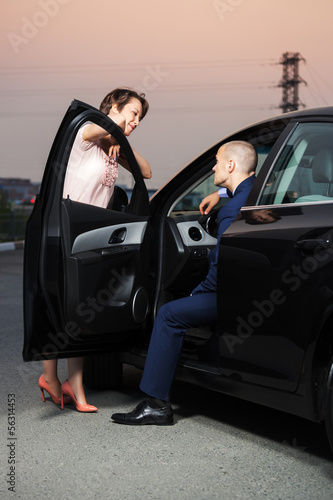 Happy young couple at the car