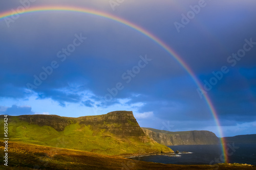 Rainbow over dramatic coast of Scottish highlands, Isle of Skye