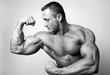 Muscular man flexing his biceps