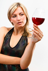 Young woman thinking about the red wine
