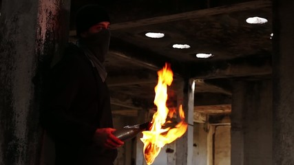 Man Dark Lighting Up Molotov Cocktail Bomb Fire Danger Concept