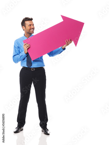 Handsome businessman holding pink arrow