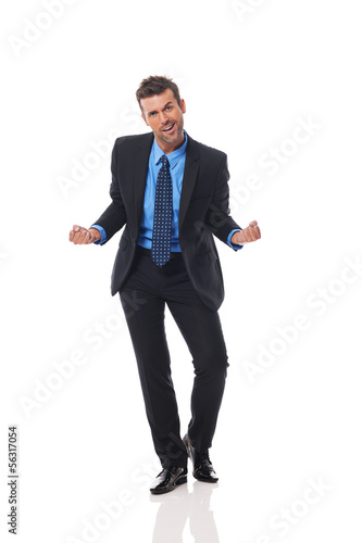 Handsome business man gesturing success sign
