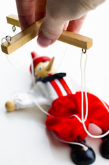 doll puppet in the hands of