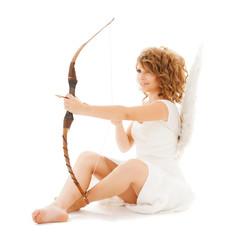 happy teenage angel girl with bow and arrow