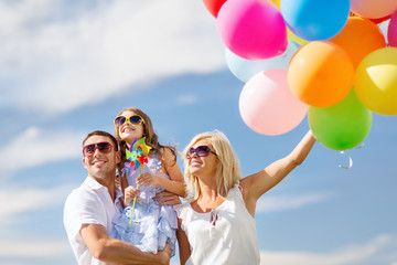 family with colorful balloons