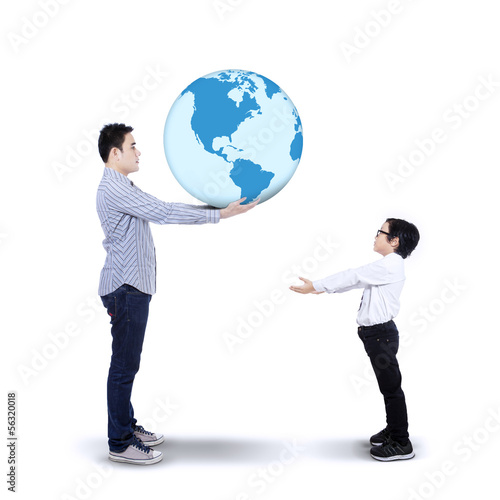 Father passing the earth to his son