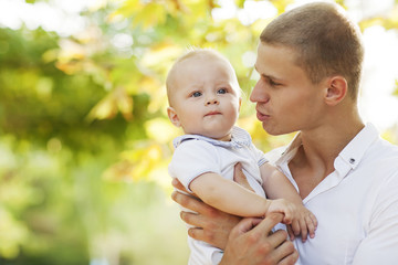Happy young man with his son
