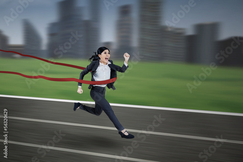 Asian businesswoman winning the race