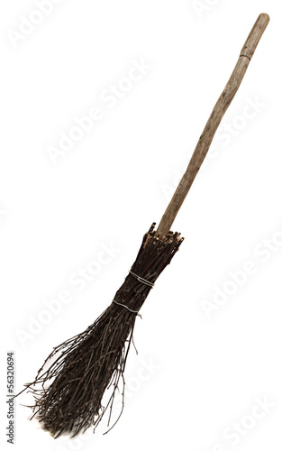Old wicked broom isolated on white.