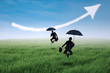 Happy insurance agent jumping with umbrella