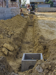 scraper during excavation for the laying of pipes