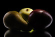 apple and pear on black background