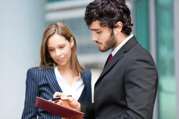 Businesspeople looking the agenda