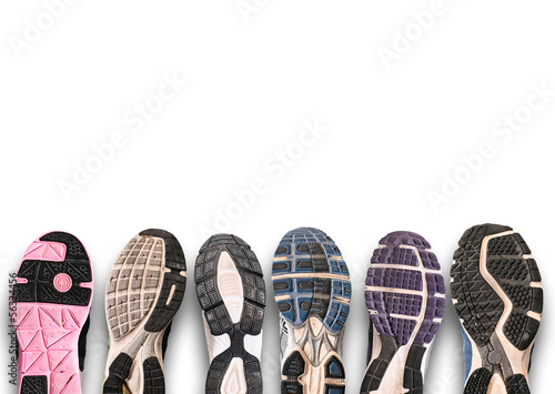 canvas print picture Different shoe sole on a grey background.
