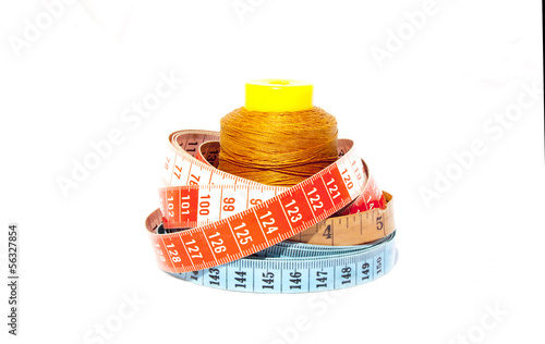 Three Tape Measures With Roll Of Cotton
