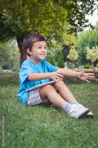 Boy with tablet at the park