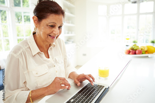 Senior Indian Woman Using Laptop At Home