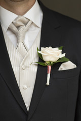 Close up of a groom's buttonhole