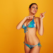 Looking up woman wearing two piece bikini