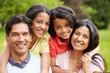 Leinwandbild Motiv Indian Family Walking In Countryside