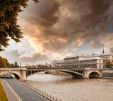 Notre Dame Bridge in Paris with Seine river and city traffic