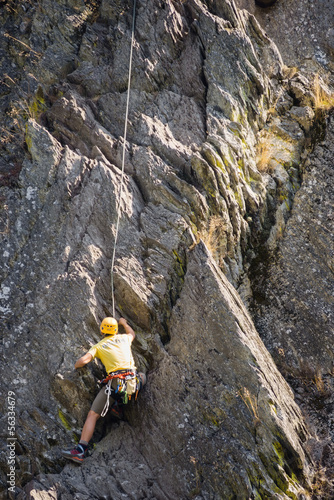 Young Man Climbing Rock
