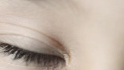 blinking blue eyes