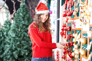 Beautiful Woman Buying Christmas Ornaments