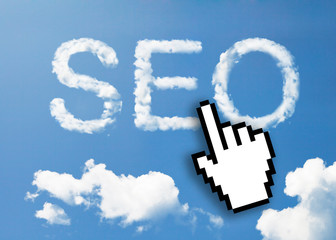 "Digital icon hand click on ""SEO"" cloud on sky"