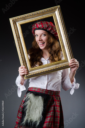 Scottish woman with frame on white
