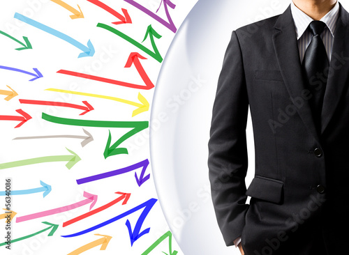 Businessman with shield protecting himself from arrow