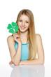 Young female holding leaf symbol